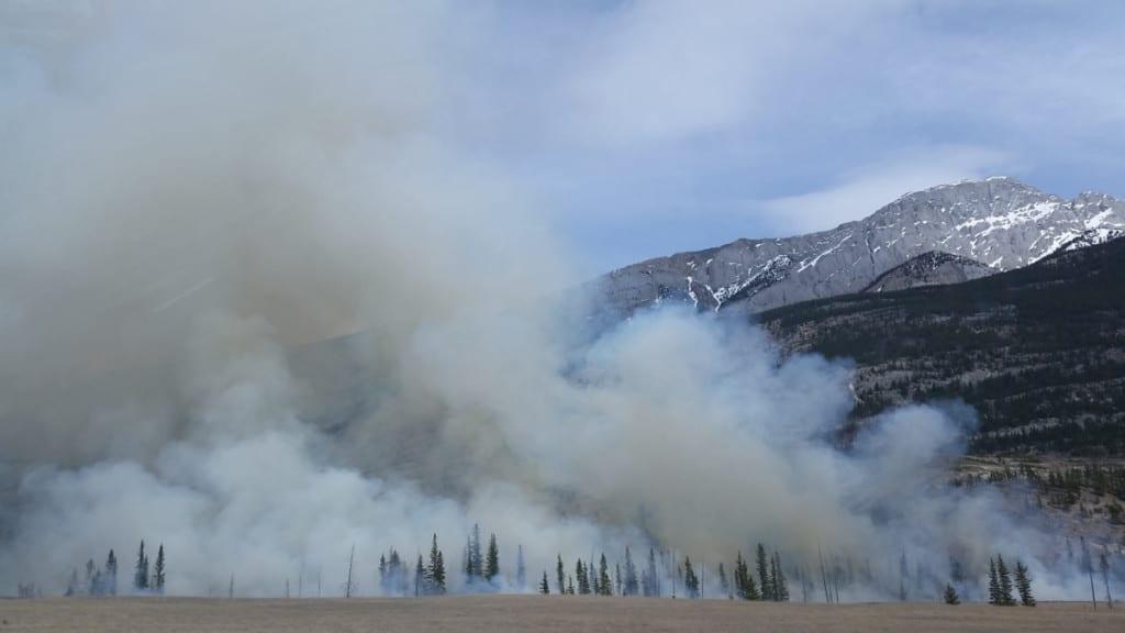 white smoke in valley of mountains
