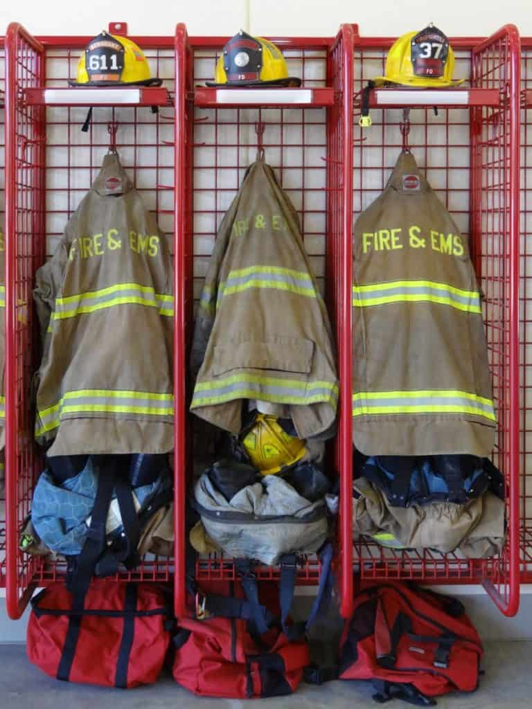 firefighter helmets and turnout gear in lockers