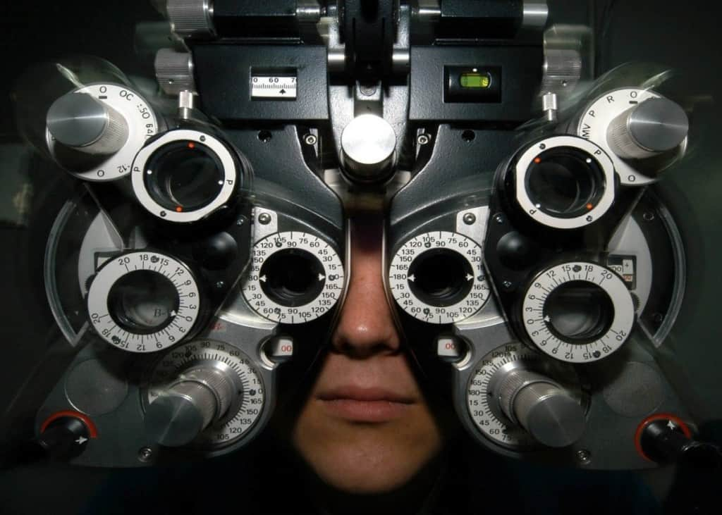 person getting an eye exam with machine