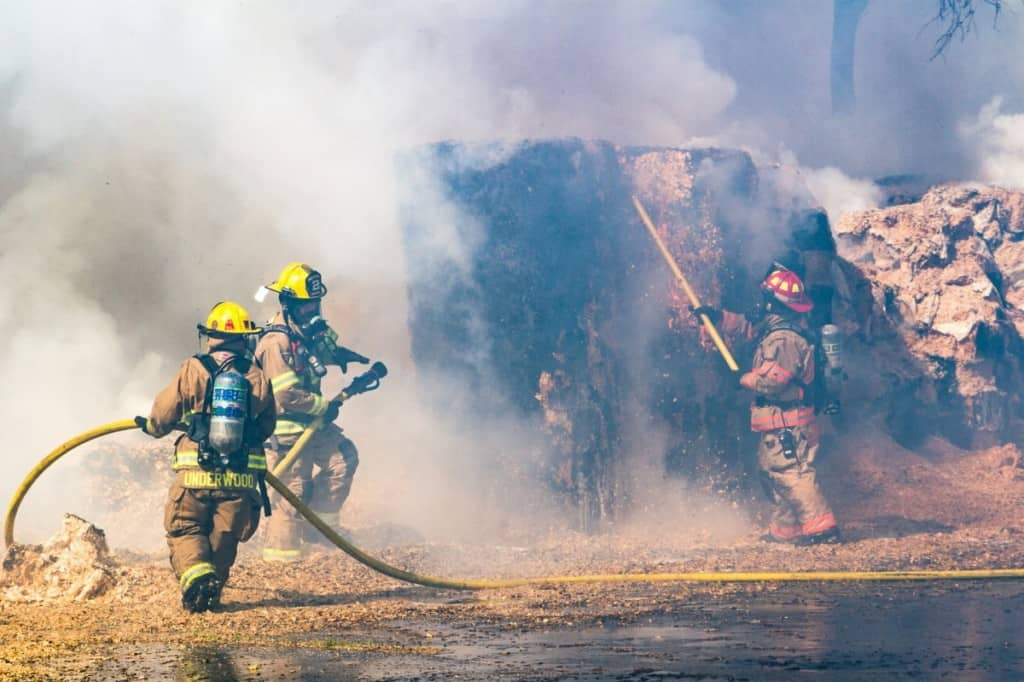 firefighters working in smoky conditions