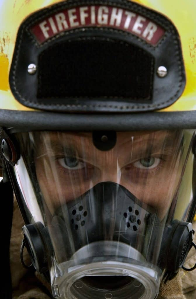 firefighter with helmet and SCBA mask on
