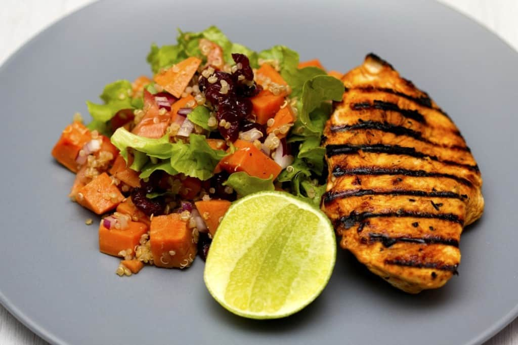 chicken breast with salad and lime