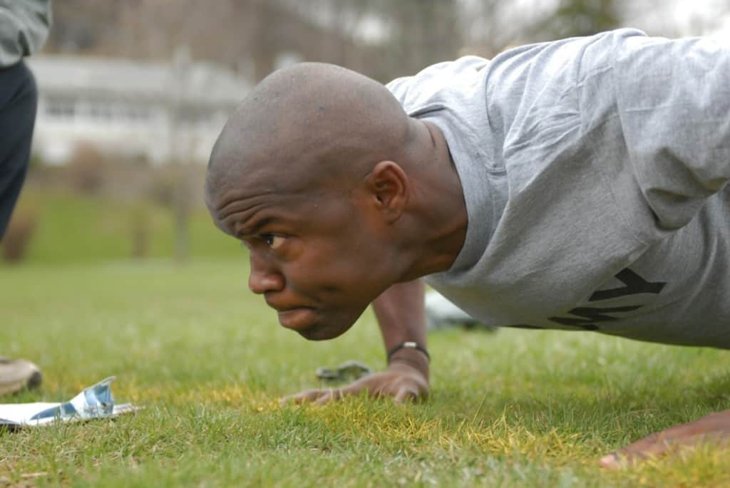 man in army doing pushups