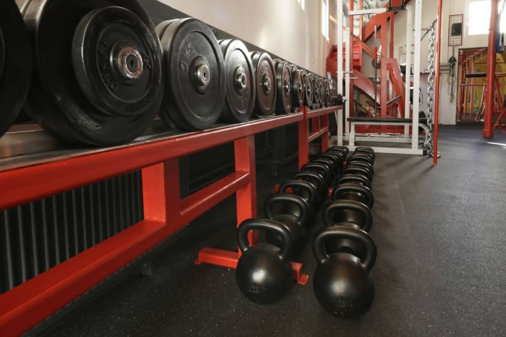 dumbbells and kettlebells on rack at the gym