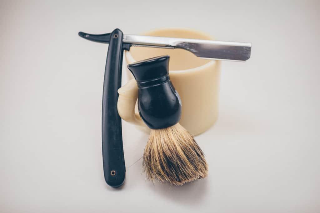 straight blade razor and shaving cream brush