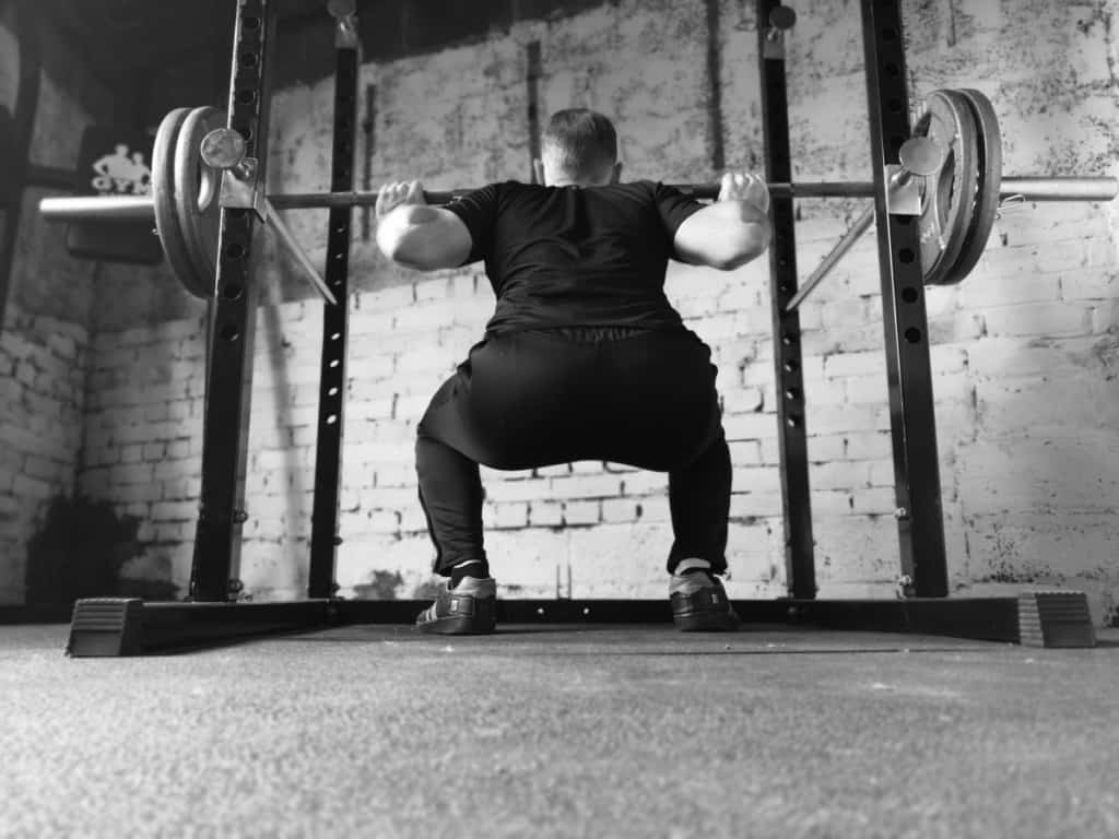 person doing a barbell back squat