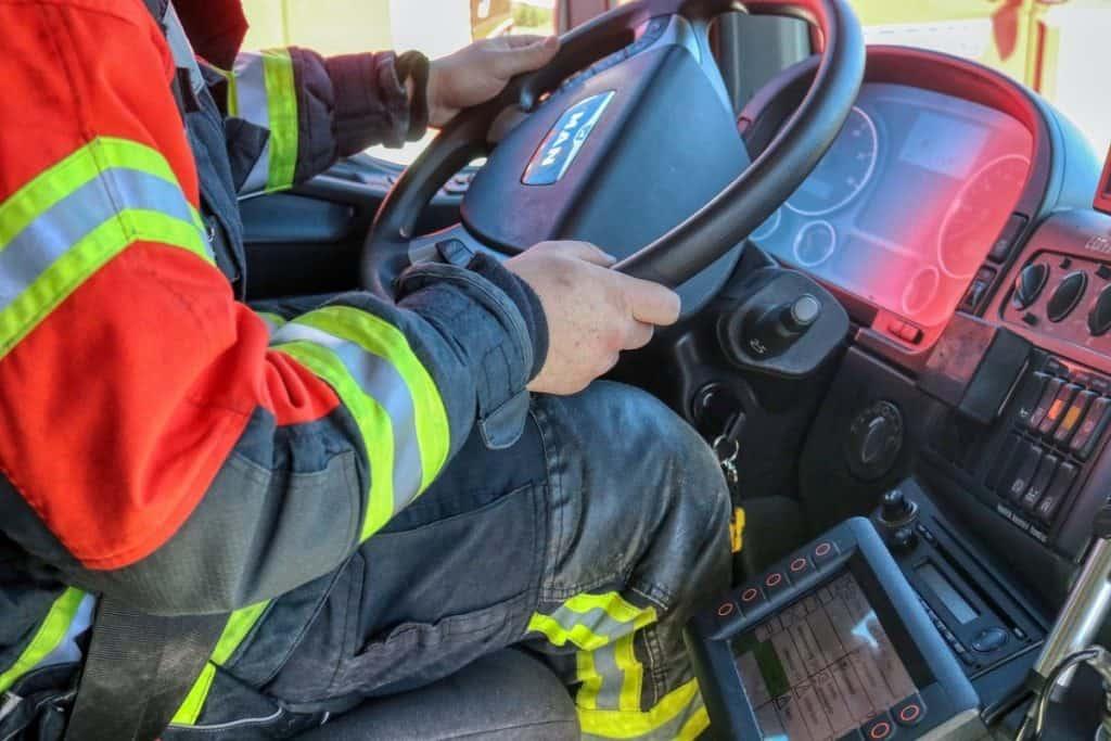 firefighter driving fire truck