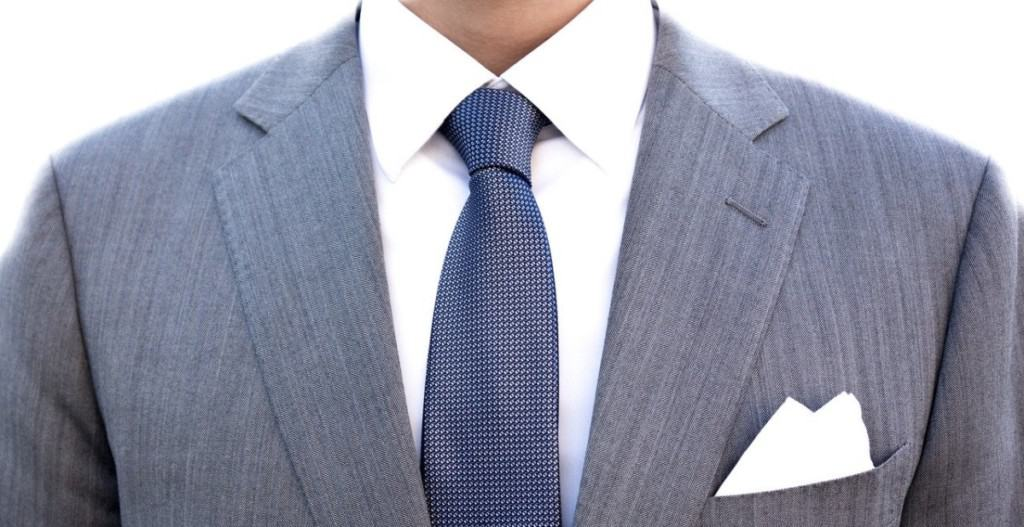 grey suit with blue tie
