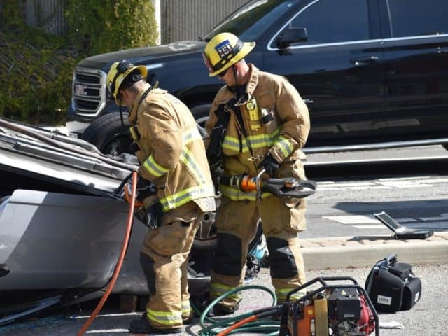 firefighters at car accident