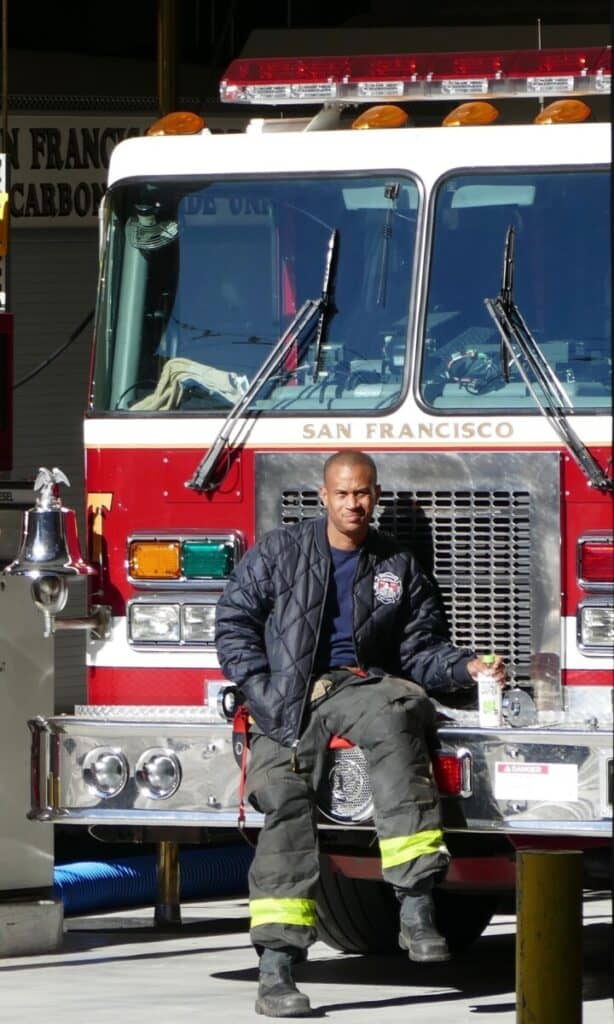 firefighter sitting on bumper