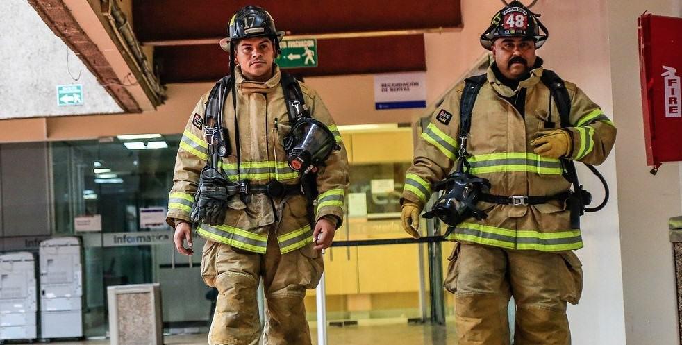 firefighters walking in turnout gear
