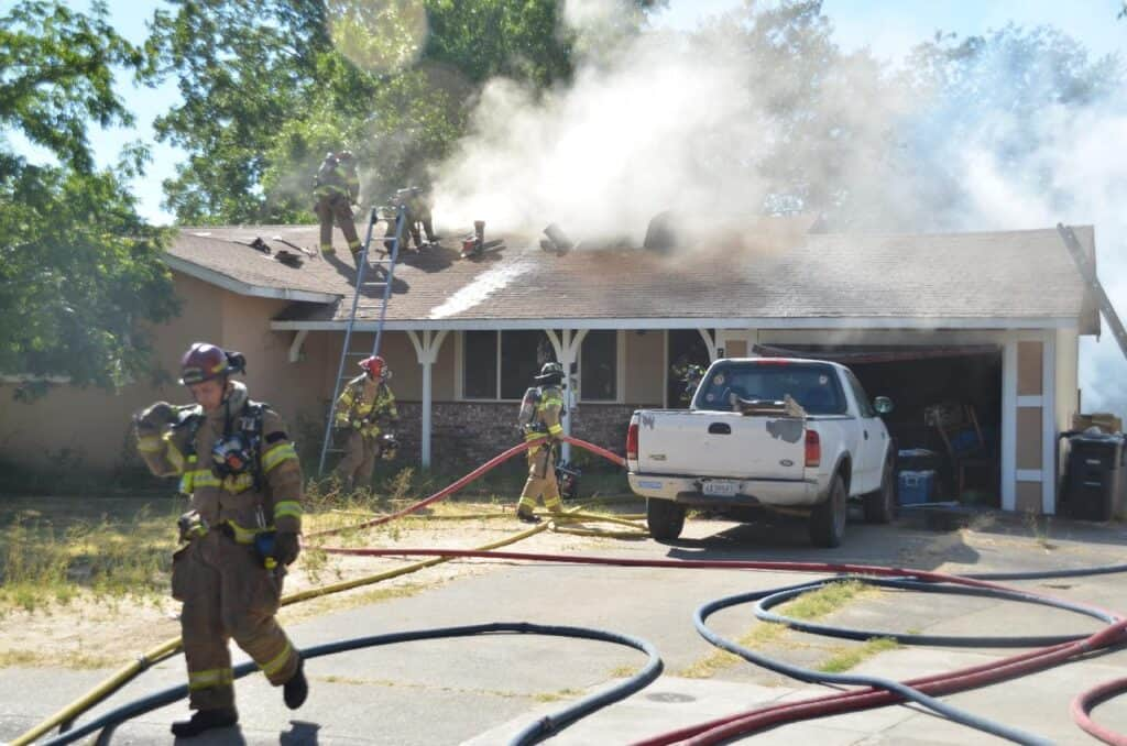 firefighters working on house fire