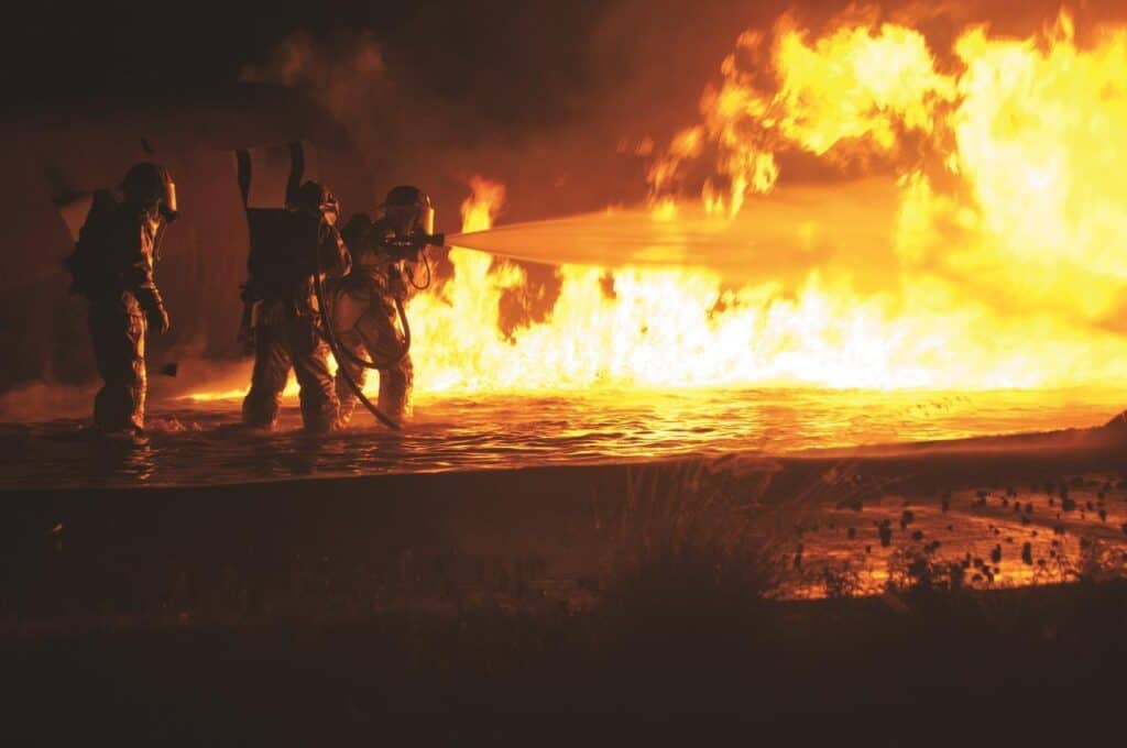 firefighters fighting liquid fire