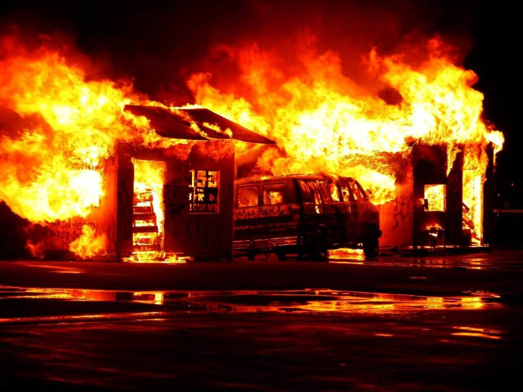 house and car burning in fire